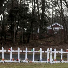 Crosses bear the names of the Newtown, Conn., shooting victims in Sandy Hook village.