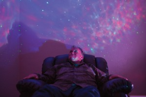 "Steve Ledwon, relaxes in the 'comfort room,' while listening to his favorite band, Pearl Jam, at Mi Esperanza Wellness Center on Tuesday, June 14, 2016 in Alamosa, CO. ""I wish I had this room at home,"" Ledwon, who calls the room the 'star room,' said. ""I would use it all the time."" The wellness center provides an alternative for people experiencing mental health crises.   Photo by Rick Scibelli, Jr. for Solutions Journalism Network"