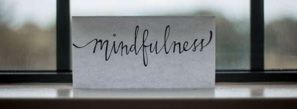a script sign reads 'mindfulness'