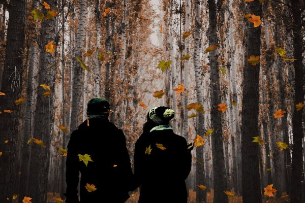 Couple walks together in nature during the fall season