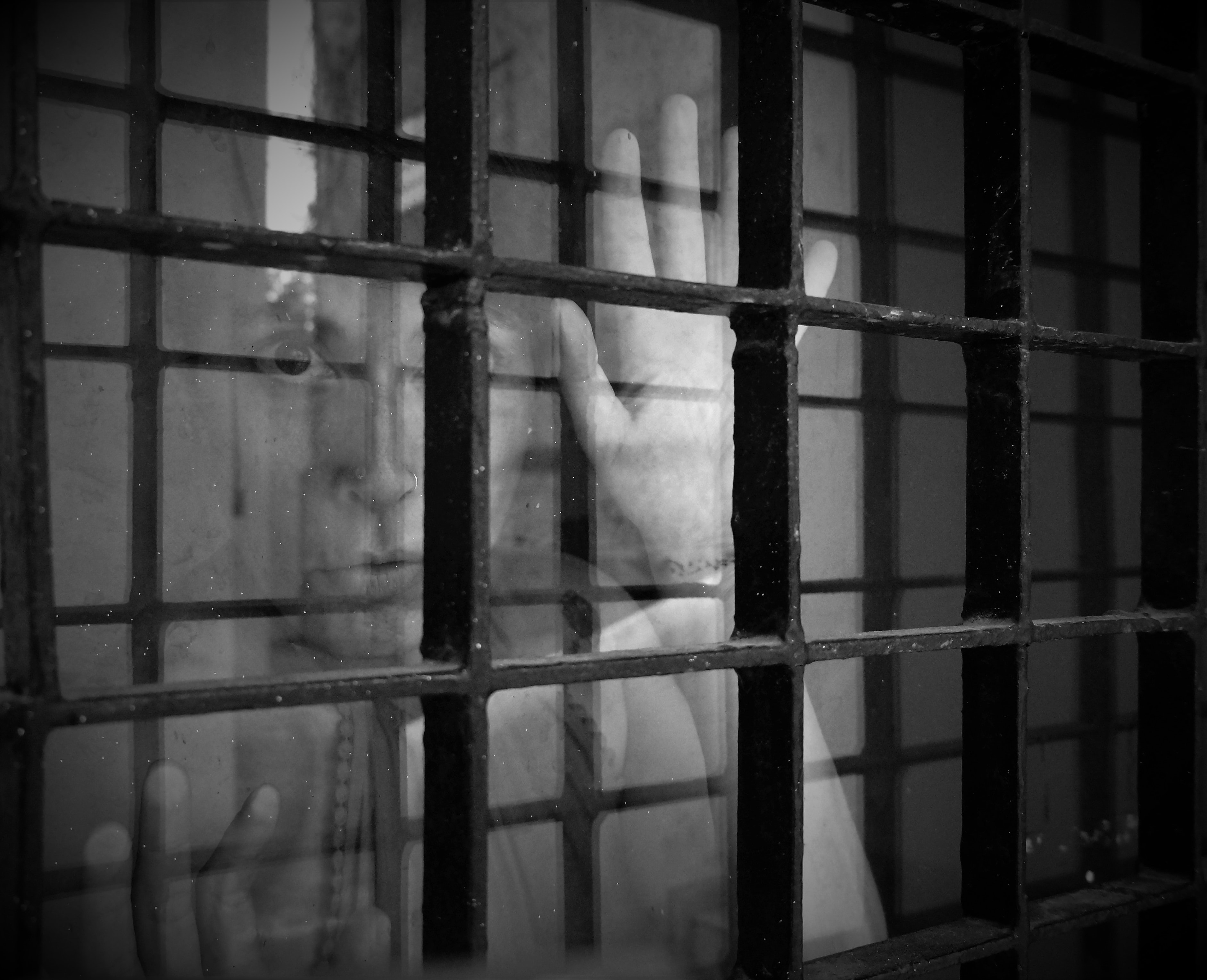 Person looking through caged window